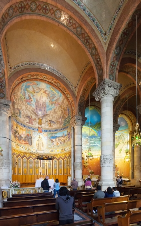 BARCELONA, SPAIN - MAY 18: Interior of Temple Expiatori del Sagrat Cor in May 18, 2013 in Barcelona, Spain. The construction of the temple  lasted from 1902 to 1961 Stock Photo - 20187869