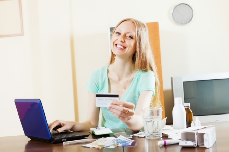 happy woman buying drugs online with laptop and credit card at home Stock Photo - 20239910