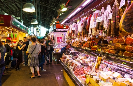foremost: BARCELONA, SPAIN - MARCH 28: La Boqueria market to La Rambla in March 28, 2013 in Barcelona, Spain. The market has been known since 1217. Now - one of the citys foremost tourist landmarks Editorial