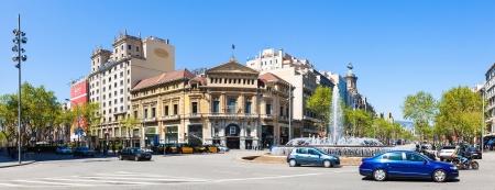 BARCELONA, CATALONIA - APRIL 14: Panorama of Crossing Gran Via de les Corts Catalanes and Passeig de Gracia in April 14, 2013 in Barcelona, Catalonia. It one of major avenue in city