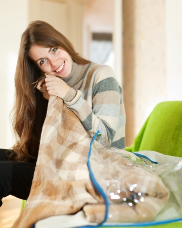 Happy woman with new plaid at home Stock Photo - 20311955