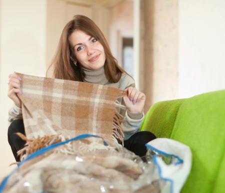 casualy: Happy woman with new plaid at home