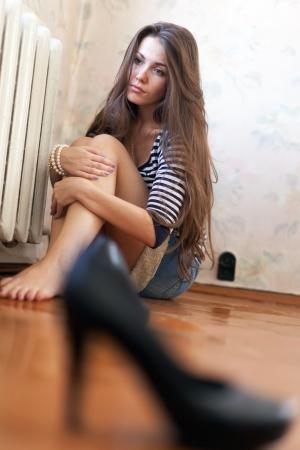 sobbing: sadness girl sitting on the floor in the corner