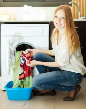 Long-haired woman doing laundry at her home Stock Photo - 20311975