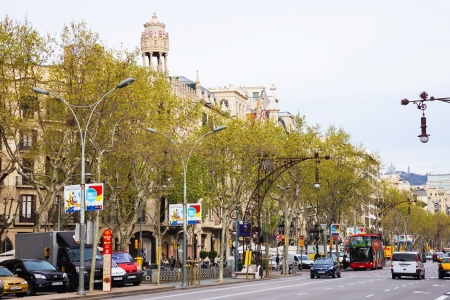 BARCELONA; SPAIN - APRIL 8: Passeig de Gracia in April 8; 2013 in Barcelona; Spain. It one of major avenue in city. Located in Eixample district. Shopping and business areas Editorial