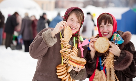 sudarium: Women in traditional  clothes tasting pancake  during  Shrovetide