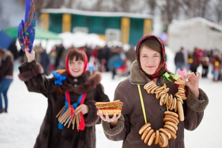 maslenitsa: Girl  in traditional  clothes with pancake during  Maslenitsa festival