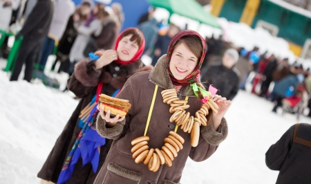 sudarium: Girl  in traditional  clothes with pancake during  Maslenitsa festival