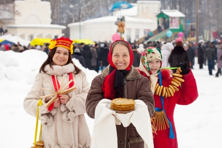mob: women  with pancakes and round cracknel during  Shrovetide in Russia