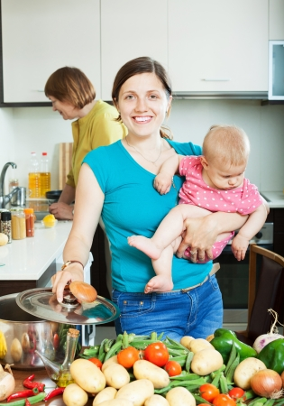 Happy family of three generations together cooking in the kitchen Stock Photo - 20433485