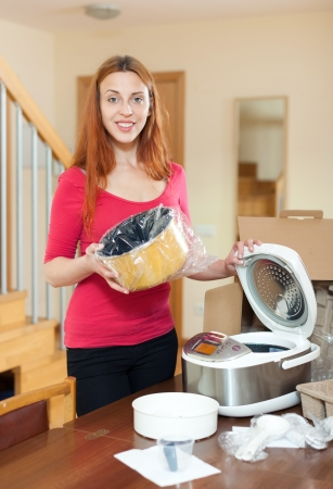 Woman with electric crock pot in her kitchen at home Stock Photo - 20454978