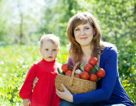 Happy  family with vegetables harvest in garden Stock Photo - 20480030