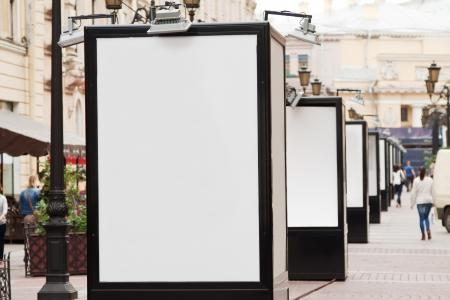 many blank billboards at city street photo