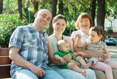 Outdoor portrait of happy multigeneration family of five sitting at park in sunny summer day Stock Photo - 20544739