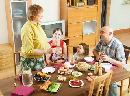 happy  multigeneration family having holiday dinner at home together Stock Photo