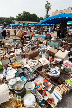 mercat: BARCELONA, SPAIN - JUNE 26:  Old things at Mercat de Encants flea market in June 26, 2013 in Barcelona, Spain. It is one of the oldest markets in Europe, has been known since the 14th century