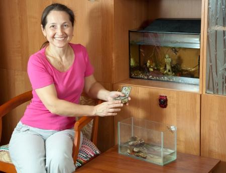 aquaria: Woman with aquariums in home