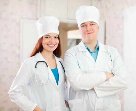 Portrait of two doctors in clinic interior photo