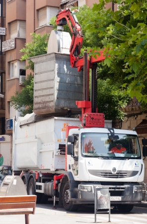 BARCELONA, CATALONIA - JUNE 23: Garbage truck collects garbage dumpster in June 23, 2013 in Barcelona, Catalonia.   Recycling truck picking up bin