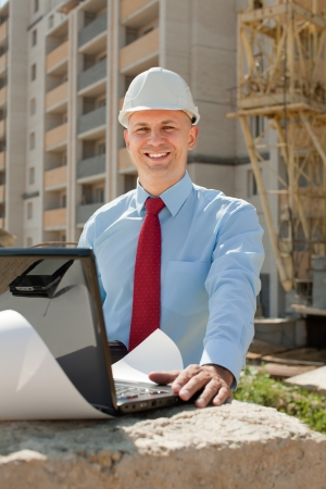 engineer's: Happy builder in hardhat works on the building site Stock Photo