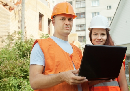 Portrait of two builders works at construction site  Stock Photo
