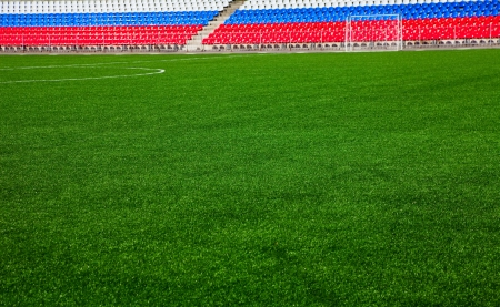 Green soccer field with stands colored in russian flag Stock Photo