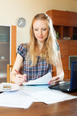 Young woman fills in the questionnaire at  home Stock Photo - 21111009