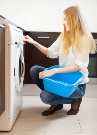 Long-haired woman with washing machine at  home Stock Photo - 21110988