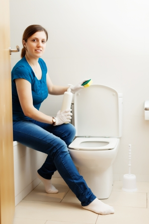 woman cleaning toilet bowl with sponge Stock Photo - 21111044