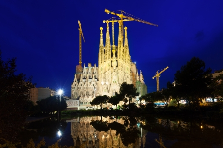 uncomplete: BARCELONA, SPAIN - JULY 14: Sagrada Familia in  evening in July 14, 2013 in Barcelona, Spain.  Basilica and Expiatory Church of Holy Family by Gaudi, building is begun in 1882 and completion is planned in 2030