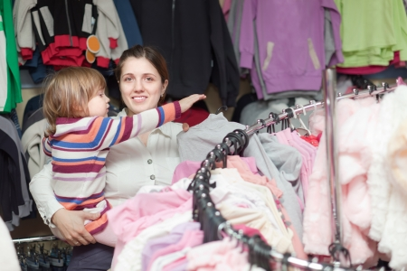 Happy family chooses wear at clothes shop Stock Photo - 21227025
