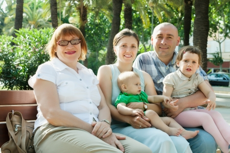 Portrait of happy three generations family sitting in summer street Stock Photo - 21234285