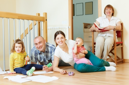 happy three generations family with two children enjoying at floor in home together Stock Photo - 21234300