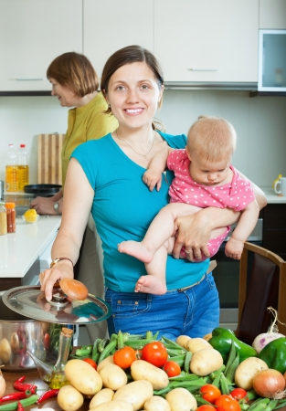 Happy family of three generations together cooking with vegetables in the kitchen Stock Photo - 21234335