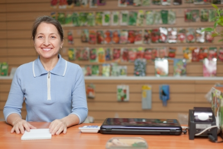 friendly mature saleswoman at shop for gardener photo