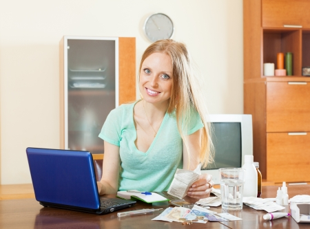 woman choosing medication online pharmacy at home photo