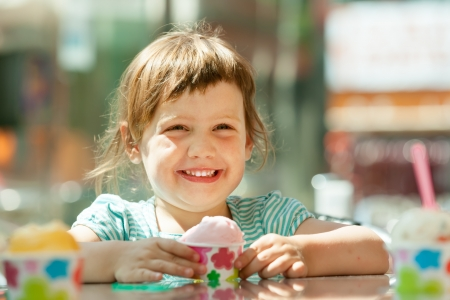 Happy 3 years child eating ice cream Stock Photo - 21321927