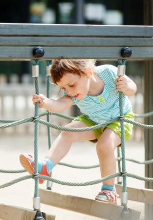 3 years baby girl  at playground in summer photo