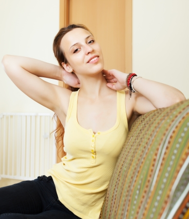 ordinary woman: Ordinary woman having  ache in neck at home Stock Photo