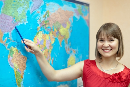 eastward: Woman showing something on world map at house