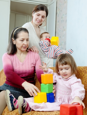 Happy women  with children in home photo