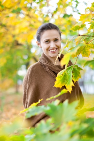Outdoor portrait of girl at autumn park  photo