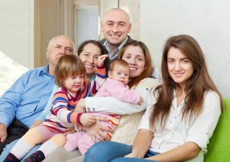Happy three generations family sits on sofa in livingroom Stock Photo - 21378710