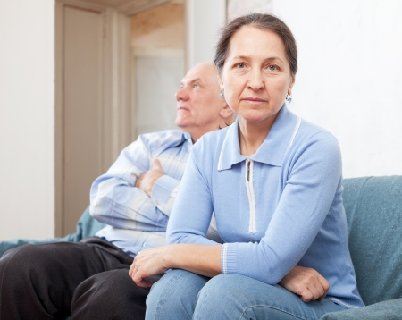 Mature couple after quarrel in living room at home  photo