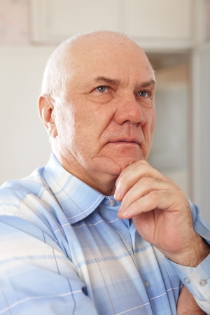 grizzled: portrait of grizzled elderly man in interior Stock Photo