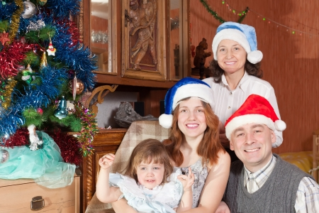 Portrait of  happy  family at home together during Christmas photo