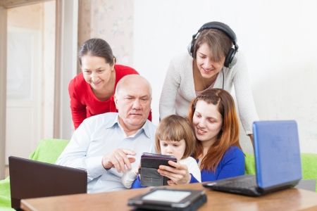 Group of people  uses few various devices at home interior   photo
