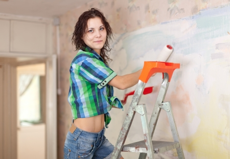 Woman makes repairs in the apartment Stock Photo - 21434437