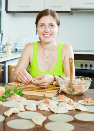 Woman making meatballs salmon stuffing and dough in the kitchen Stock Photo - 21500583