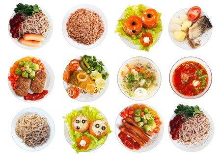 Top view of many plates with food over white background photo